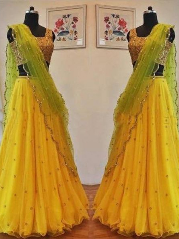 Surpassing Yellow Color Net With Embrodery Lehenga Choli